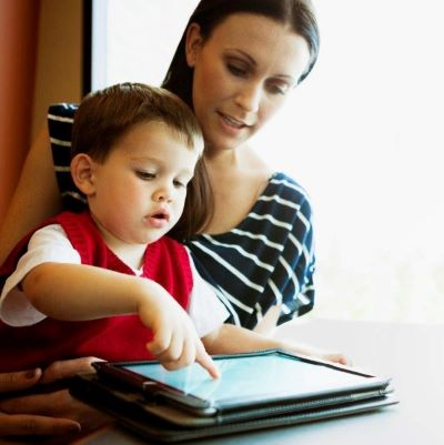 Image of woman and toddler looking at a tablet computer