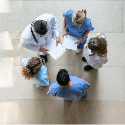 healthcare professionals in a meeting in a hospital lobby
