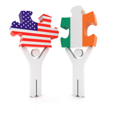 Flags of Ireland and the U.S. as jigsaw pieces being held above two people's heads