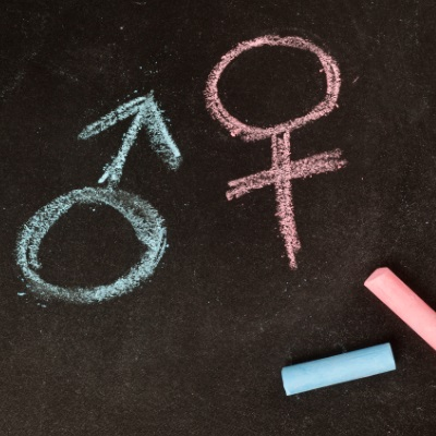 gender symbols written in chalk on a blackboard