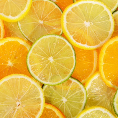 all sorts of citrus fruits sliced close up